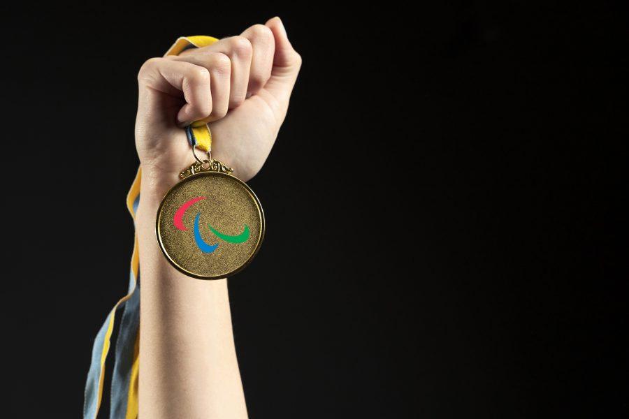 Athlete holding gold medal closeupv2